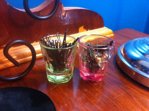 Shot glasses can be a cool way to store small items like bobby pins and earrings.