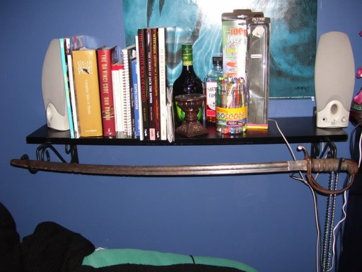 A shelf I built 8 years ago with bird feeder hangers, and a great place to display my sword.